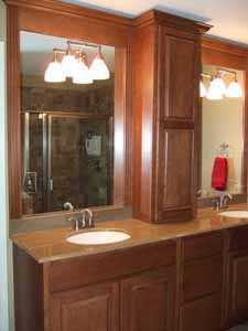 cherry cabinets and granite countertops in remodeled bathroom lg