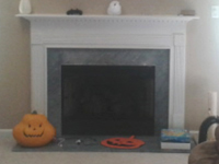 traditional fireplace before remodel