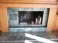 marble hearth installation with oak surround and trim
